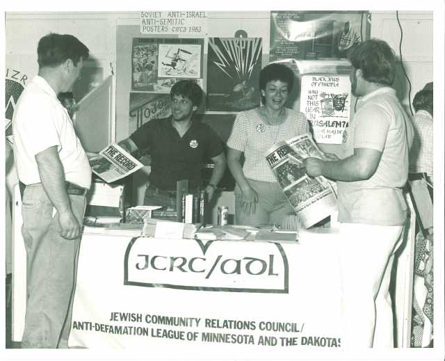 Black and white photograph of booth staffed by members of the JCRC/ADL at the Minnesota State Fair, c.1986.