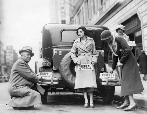 Black and white photograph of people with bumper stickers advocate the repeal of the 18th Amendment (Prohibition), 1932.