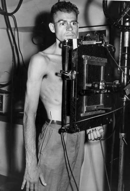 Black and white photograph of volunteer Jim Plaugher of Fresno, California, at an x-ray checkup, c.1944.