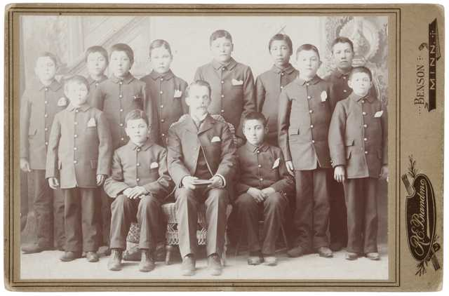 Teacher and students, Morris Indian School, ca. 1895. Included are B. LeVivash, Joe Northrup, and Joe Siehy. Photograph by R. E. Brandmo.