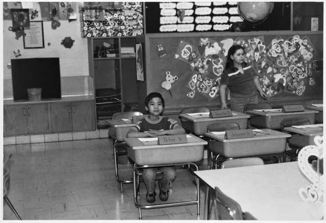 Pitaro (Peter) Khouth, a Cambodian Minnesotan, in his classroom at Centennial School in Richfield, ca. 1980.