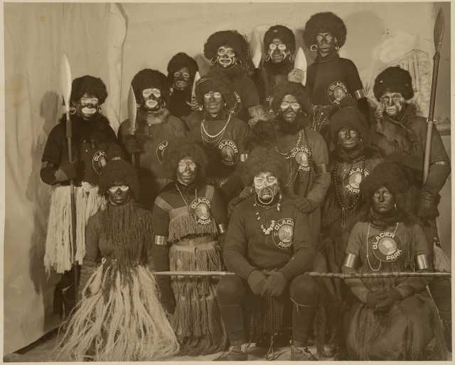"""Participants in the 1916 St. Paul Winter carnival pose in their """"Africa costumes."""""""