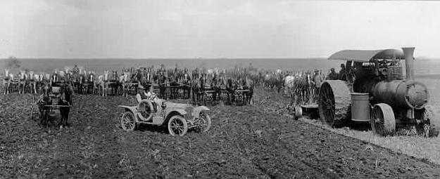 Black and white photograph of men, horses, farm implements in field, Northcote farm, Northcote, Minnesota, 1914. Photograph by William Hartvig.