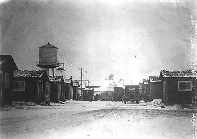Black and white photograph of the main Street of the Milford Mining Company in Crosby, 1924.