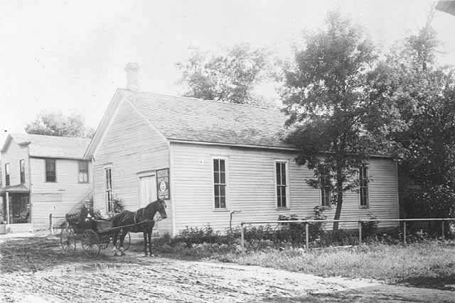Black and white photograph of a Grange Hall, in Bloomington, c.1890.