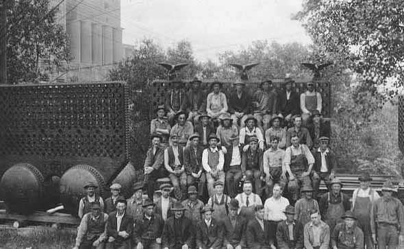 "Black and white photograph of workers posed by Pillsbury ""A"" Mill in Minneapolis, ca. 1918."