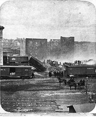 Black and white photograph of the ruins of the Pettit, Zenith, and Galaxy Mills after Washburn A Mill explosion on the Mississippi Riverfront, 1878.