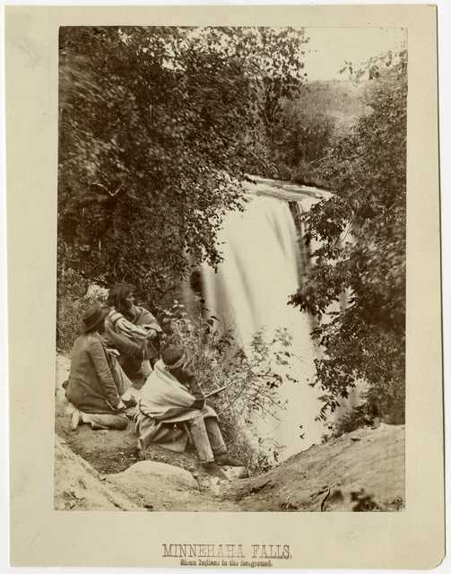 Black and white photograph of Minnehaha Falls, Dakota Indians in the foreground, 1857.