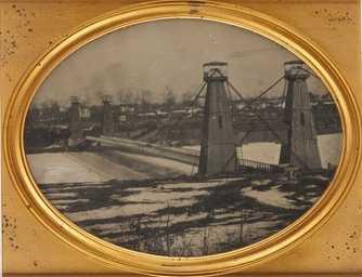 Black and white, daguerreotype-style photograph of the Hennepin Avenue Bridge, c.1857.