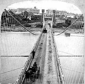 Black and white photo negative of the Hennepin Avenue Bridge, c.1868.