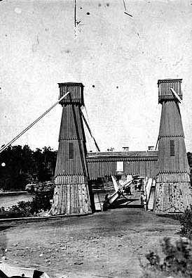 Black and white photograph of the Hennepin Suspension Bridge, c.1865.