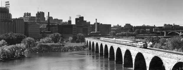 Black and white photograph of the Great Northern Railway's Winnipeg Limited crossing the Stone Arch Bridge, Minneapolis, ca. 1955.
