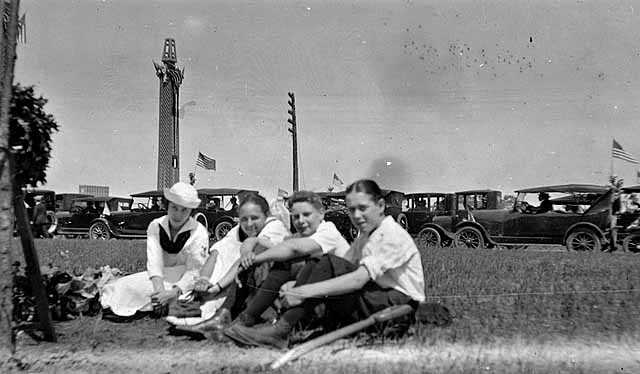 Group next to memorial tree planted on Victory Memorial Drive