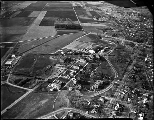 Black and white aerial view of Gustavus Adolphus College, St. Peter, 1954. Photograph by Minneapolis Start Journal Tribune.