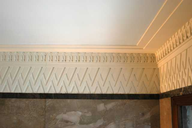 Color image of zig-zag plastered crown molding inside the Minnesota Building, 2009.