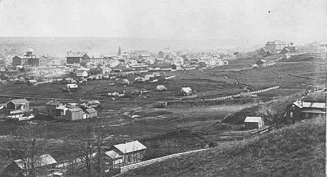 Black and white panoramic view of St. Paul, showing the State Capitol, background left, ca. 1870