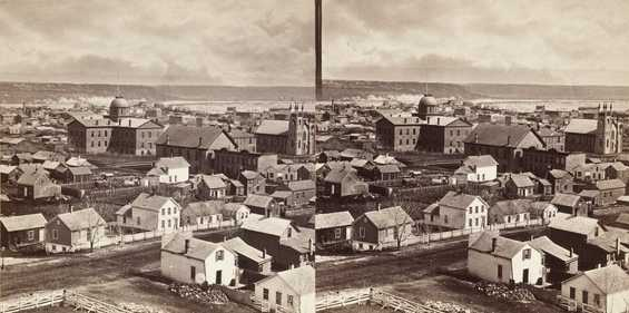 Black and white view of St. Paul from Park Place Hotel, looking southeast toward the first State Capitol, ca. 1871.