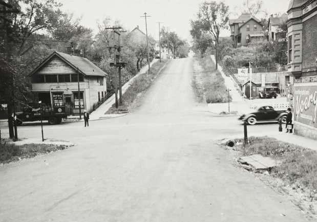 Black and white photograph looking south down Arundel Street from Rondo Avenue, ca. 1940.