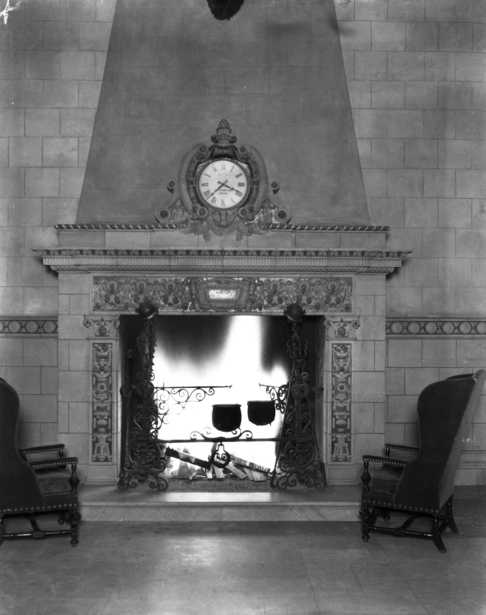 Black and white photograph of the baronial fireplace in the lobby of the St. Paul Athletic Club, c.1925.