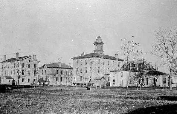 Black and white photograph of the grounds of the Minnesota State Reform School. Taken by T.W. Ingersoll c.1875.
