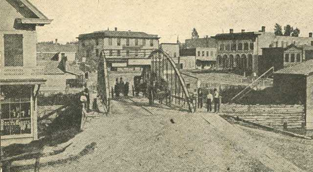 Black and white photograph of Bridge Square, Northfield, 1876.