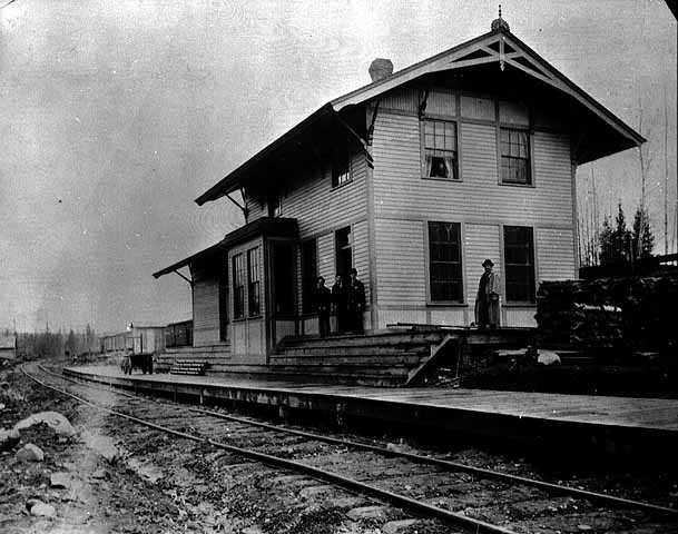 Black and white photograph of the first train depot, built by the Merritts at Mountain Iron, 1893.