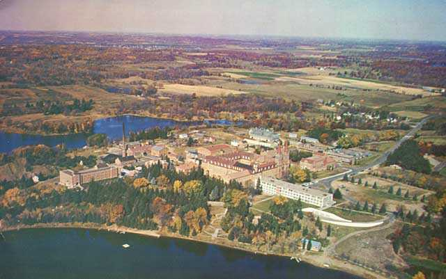 Aerial color photograph of Saint John's Abbey and University in Collegeville. Created by Henry Anderl c.1960.