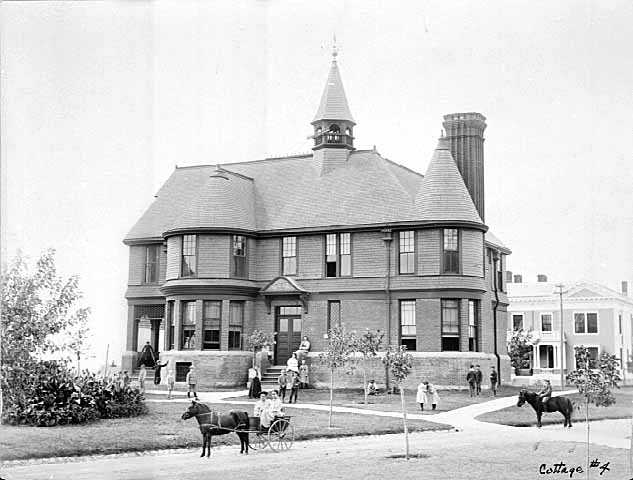 Back and white photograph of the exterior of Cottage Four at the State School, c.1900.
