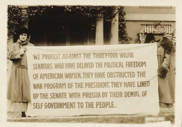 Bertha Moller holding a banner