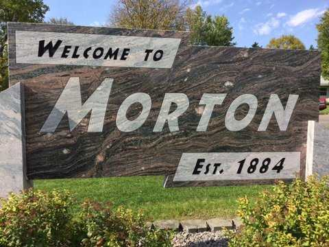 Color image of a sign welcoming visitors to the city of Morton, 2016. The sign is made out of Morton gneiss. Photograph by Paul Nelson.