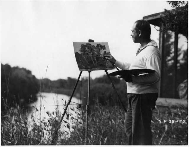 Black and white photograph of Clement Haupers painting at Rutledge, c.1934.