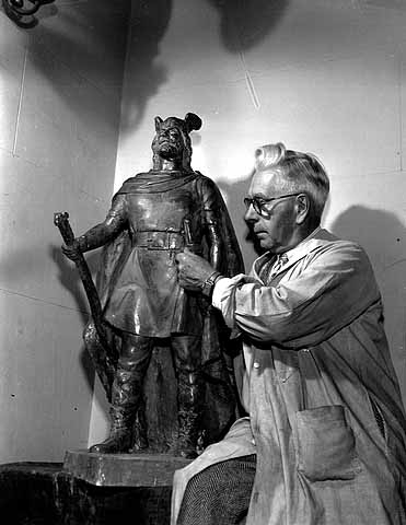 Sculptor John Karl Daniels with a model of his Leif Erikson statue