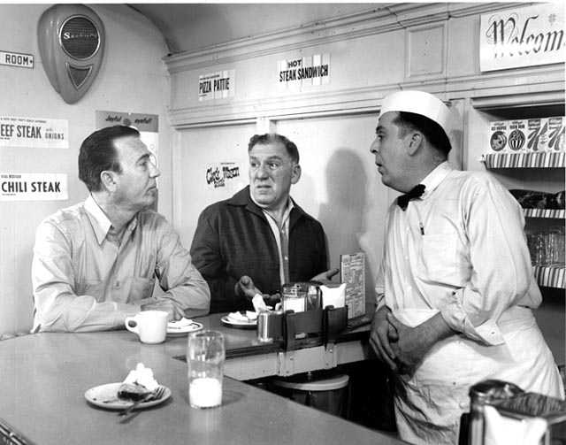 Reid Ray Film Industries films a scene for the movie <em> Cash on the Barrelhead</em> inside Mickey's Diner. Actor William Bendix is at center.
