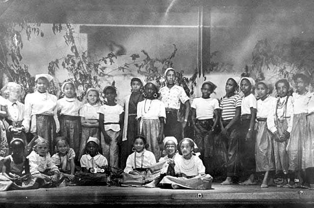 Black and white photograph of a children's theater group at the Phyllis Wheatley House, ca. 1960.