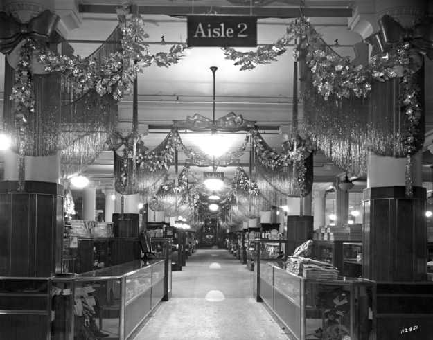 Black and white photograph of the main floor decorated for Christmas, c.1935.