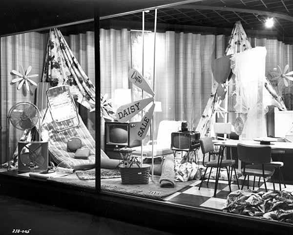 Black and white photograph of Daisy sale window display, Dayton's, 1956.
