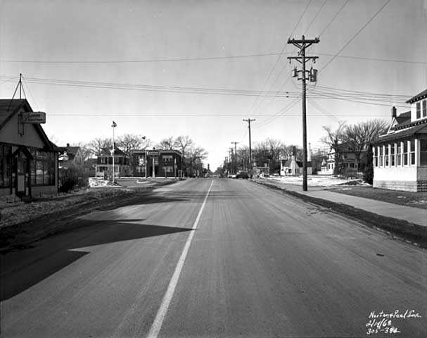 Black and white photograph of East 38th St near Portland Ave, Minneapolis, 1968.