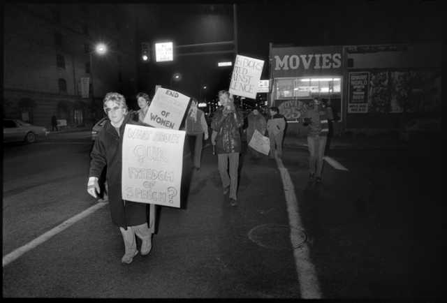 Black and white photograph of a Anti-pornography protest on Lake Street, 1984.