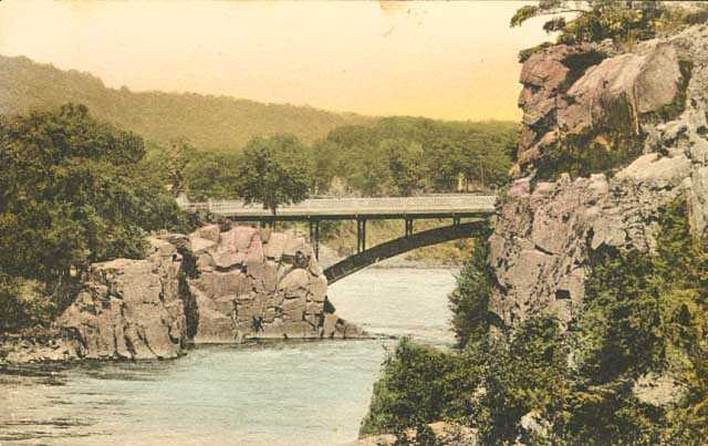 Colorized post card view of Old Man of the Dalles of the St. Croix and bridge over the river, 1920.