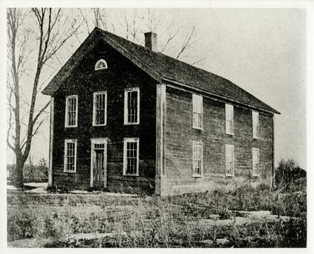 Black and white photograph of St. Ansgar's Academy, predecessor of Gustavus Adolphus College, located in East Union, Carver County from 1863–1876.