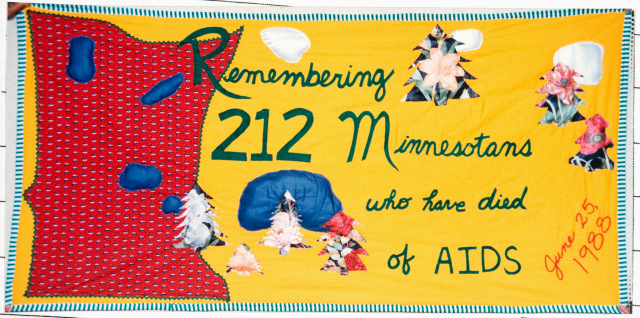 Color image of a quilt panel memorializing 212 Minnesotans who had died of AIDS, 1988.