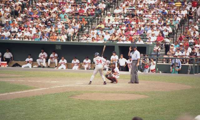 Color image of Kirby Puckett batting against the Baltimore Orioles during a game at Camden Yards.