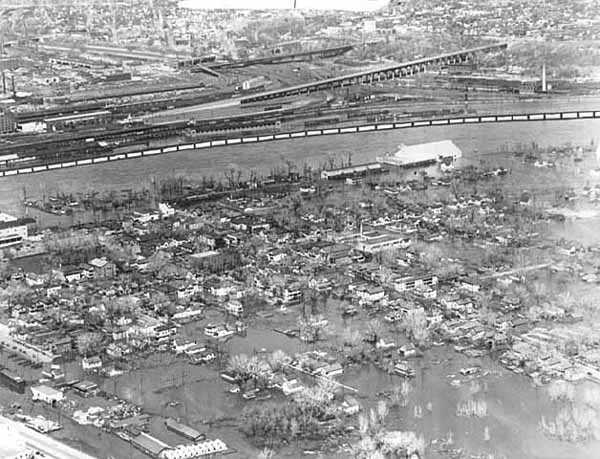 Black and white aerial view of West Side during flood, 1952.