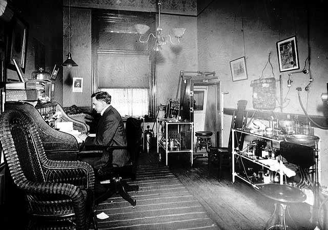 Black and white photograph of Dr. Henry Longstreet Taylor in his St. Paul office, 1896.