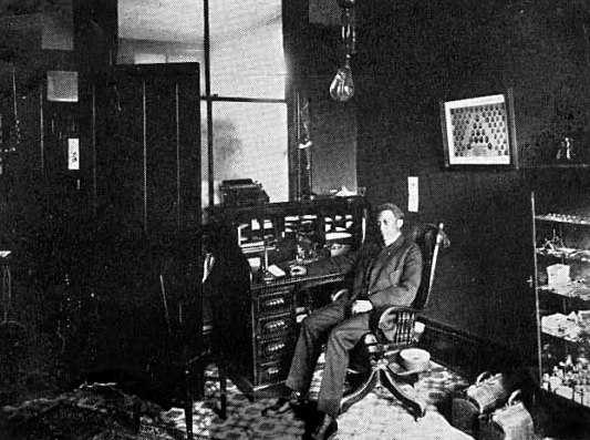 Black and white photograph of Dr. Valdo Turner in his office, c.1915.