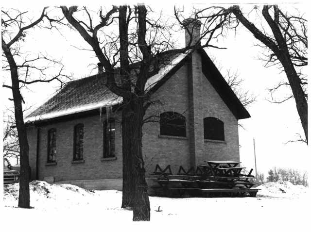 Photograph of the Ramsey District #28 School House after it was repurposed as the Ramsey Town Hall. Photographer unknown, ca. 1970s. Public domain.