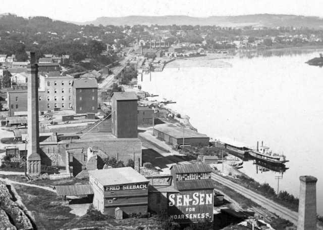 Black and white photograph of Red Wing riverfront including remnants of Red Wing Mills, c.1885.