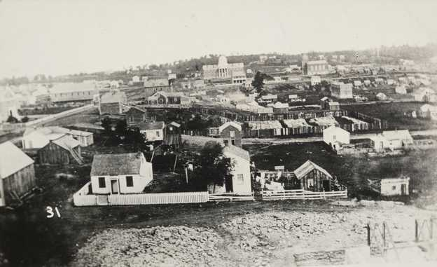 Black and white view of St. Paul looking toward the first capitol building, 1857. Photographed by Edward Augustus Bromley.