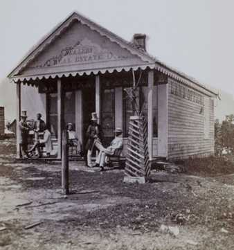 Black and white photograph of the first real estate office in Minneapolis, c.1855.