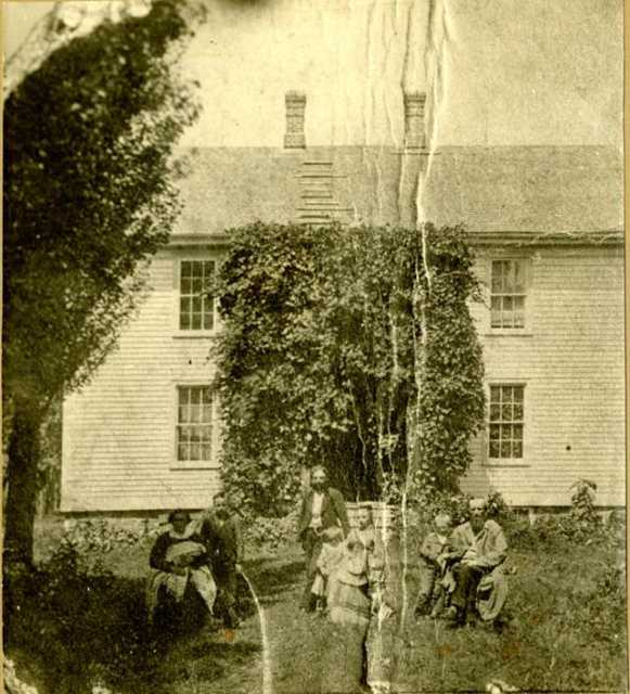 Black and white photograph of the Reverend Bernt J. Muus and family outside of Holden Parsonage in Kenyon, c.1875.